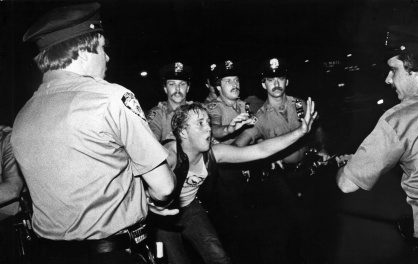 A scene during the 1969 Stonewall riots, as seen in Kate Davis and David Heilbroner's documentary STONEWALL UPRISING.  A First Run Features Release.  Photo by Bettye Lane.